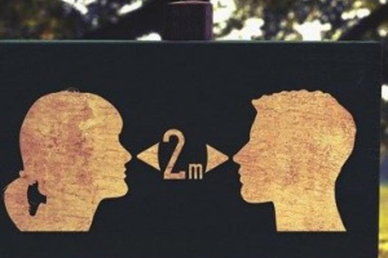 Silhouette heads of woman and man shown 2 metres apart