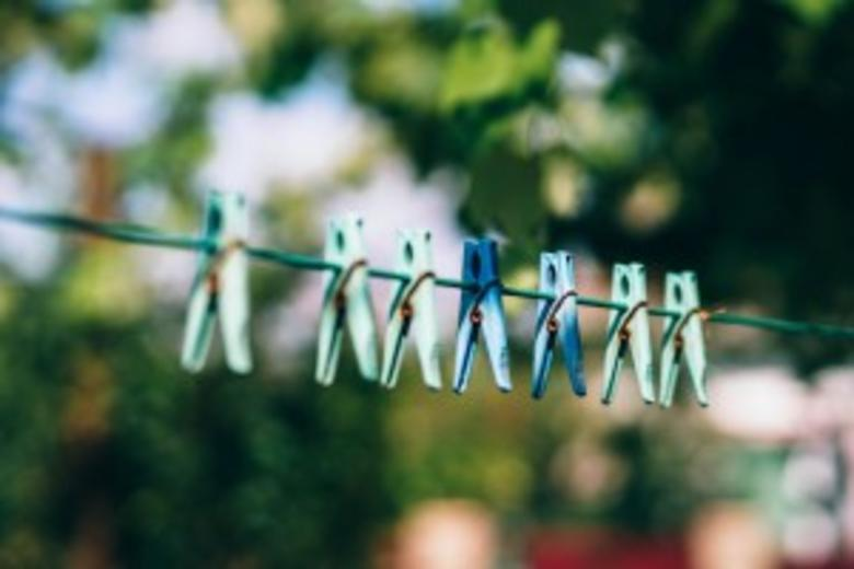 Pegs on a washing line.