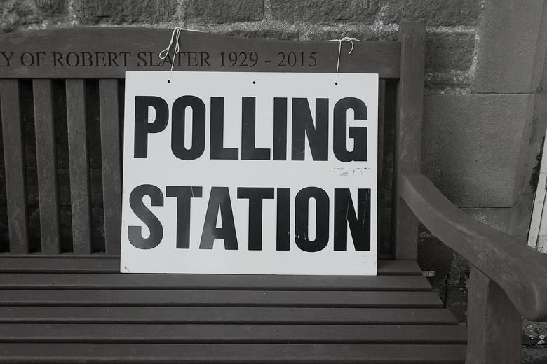 Polling Station sign on wooden bench