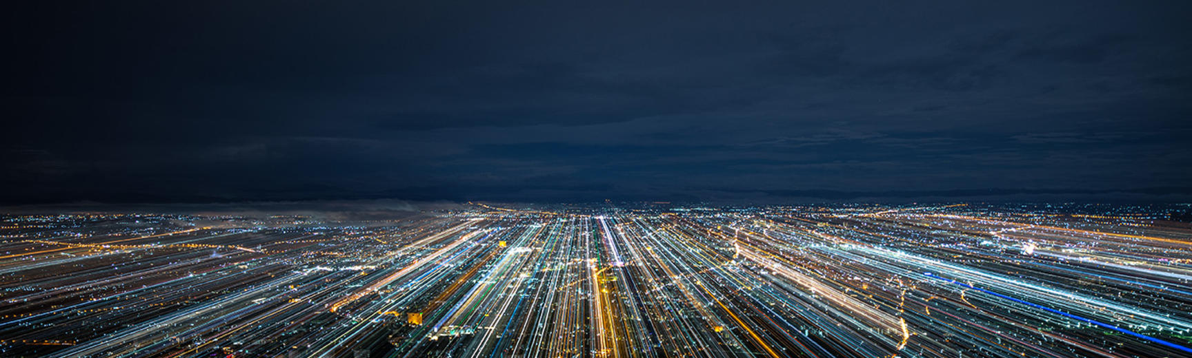 A city at night with blurred light trails